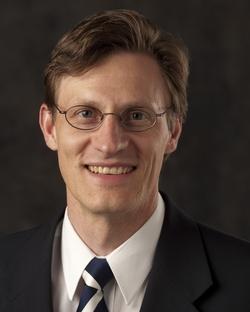 Adam T Woolley